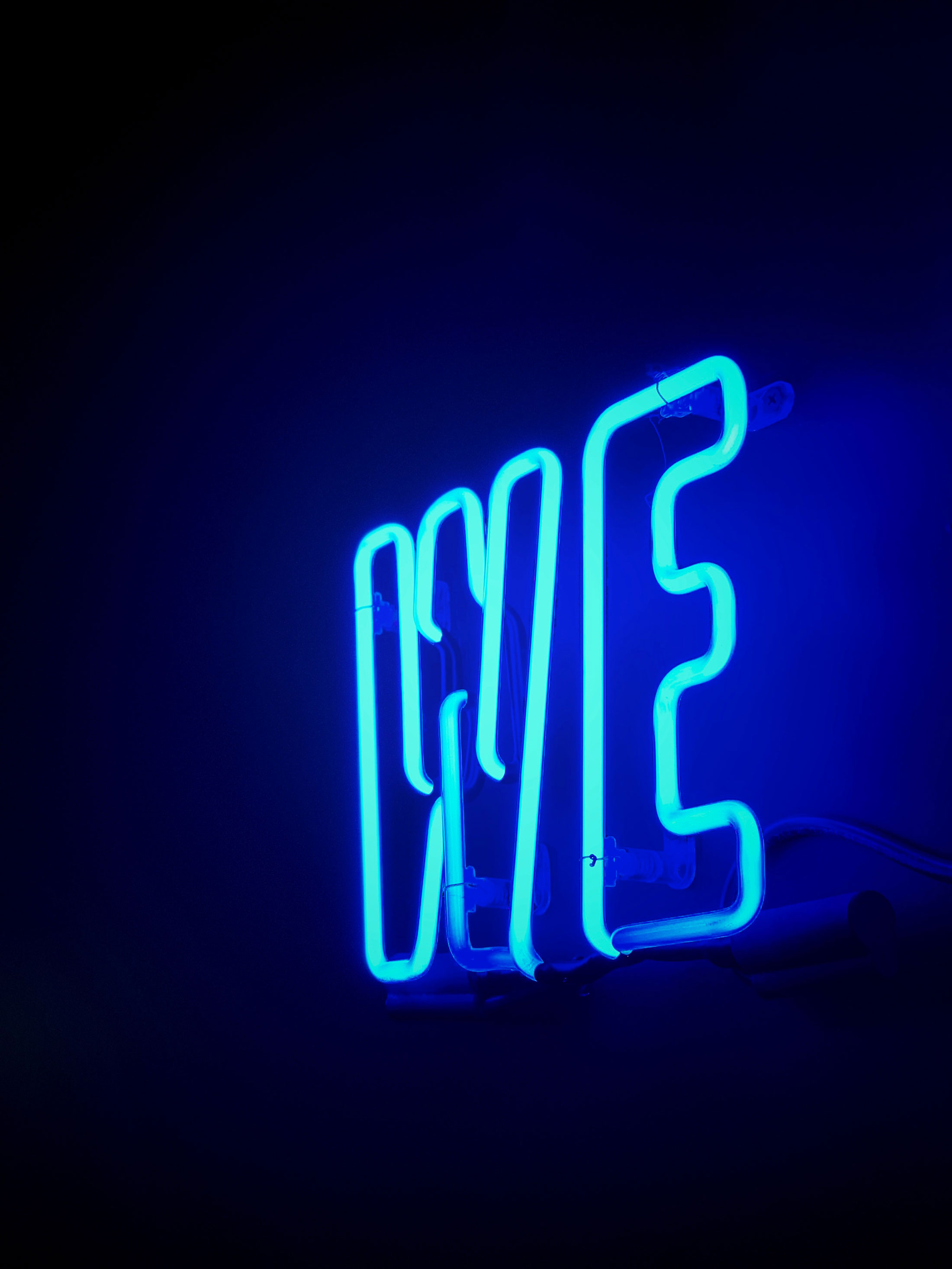 "Neon sign saying ""we."""